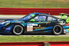 Porsche 911 GT3 Cup. Spencer Pumpelly races the Porsche 911 GT3 Cup for the TRG sponsored Race team at the professional motorsports racing event, International Royalty Free Stock Photography