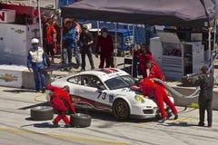 Porsche GT2 no batente do poço em AM grande Rolex compete imagens de stock royalty free