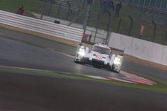 Porsche 919 hybrid Racing. Porsche 919 Hybrid competing at the 6 Hours of Silverstone at its debut race after retuning to world endurance racing in 2014 royalty free stock photo
