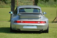 Back view on Porsche 911, model 993. The Porsche 993 is the internal designation for the Porsche 911 model manufactured and sold between January 1994 and early royalty free stock photo