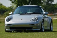 Silver Porsche 911, model 993. The Porsche 993 is the internal designation for the Porsche 911 model manufactured and sold between January 1994 and early 1998 stock images