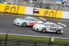 Porsche-laufende Autos Lizenzfreies Stockbild