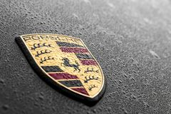 Porsche logo. In a black car, with water raindrops Stock Image