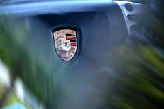 Porsche logo. Porsche car logo blured steering wheel royalty free stock photography
