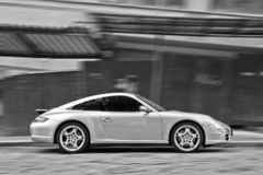 Kyiv, Ukraine, April 4, 2015. Porsche 911 in motion. black and white photo. Porsche 911 in motion. black and white photo royalty free stock image