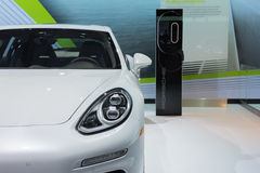 Porsche Panamera S E-Hybrid 2015 with watt station on display Stock Photography
