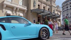 Porsche 911 Parked In Front Of Monte Carlo Casino In Monaco. Monte-Carlo, Monaco - June 20, 2019: Sportscars Parked In Front Of Monte Carlo Casino In Monaco stock video footage