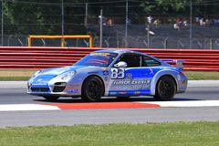 Porsche racing. Sport Porsche 997 races on the track for BGB Motorsports team at the professional motorsports racing event, International Motor Sports stock photo
