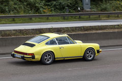 Porsche 911 on the road. FRANKFURT, GERMANY - JULY 12, 2016: Old Porsche 911 sportscar driving on the highway in Germany Royalty Free Stock Images