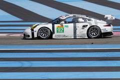 Porsche 911 RSR and the blue lines. LE CASTELET, FRANCE, March 28, 2015 : Porsche 911 RSR Le Mans Grand Tourism during the training sessions for World Endurance Stock Photos