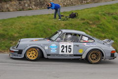 Porsche 911 SC  race during the 64th Sanremo rally. Porsche 911 SC race during the 64th Sanremo rally conducted in the race crew Rimoldi-Galli Royalty Free Stock Image