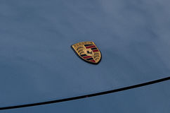 Porsche sign on the blue car hood Royalty Free Stock Photo