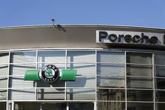 Porsche and Skoda auto logos on a of czech dealership building Stock Photography