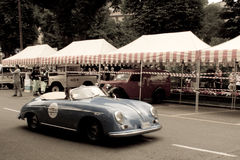 Porsche 356 Speedster at Bergamo Historic Grand Prix 2015. A blue Porsche 356 Speedster turning through Colle Aperto in Citta' Alta (the medieval part of Bergamo Royalty Free Stock Image