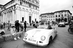 A Porsche 356 1500 Speedster, driven by Wolfgang and Ferdinand Porsche, takes part to the 1000 Miglia. LUCCA (LU), ITALY - MAY 16: A Porsche 356 1500 Speedster Royalty Free Stock Images
