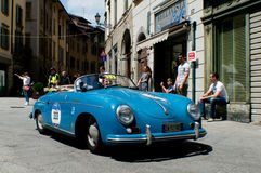 Porsche 356 Speedster at Mille Miglia 2016. A white Porsche 356 Speedster passing through Tasso street Bergamo, Italy before the crowd during the 2016 Mille Royalty Free Stock Images