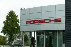 Editorial: 09.23.2018 Willich, Germany: Porsche brand logo letters store. Porsche Store on a rainy day in Germany stock image