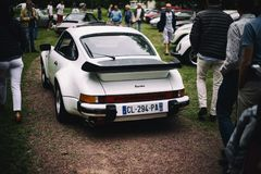 Porsche Carrera 911 Turbo. Back view of lengendary German made classic Porsche 911 Carrera Turbo 1987 at Le Touquet France vintage car owner exhibition Royalty Free Stock Images