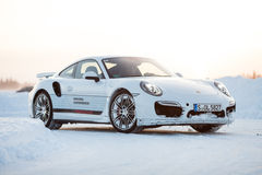 PORSCHE 911 TURBO. LEVI, FINLAND - FEB 20: Unknown driver drives a PORSCHE 911 TURBO car during Porsche Driving Experience Snow & Ice Press Event on February 20 Royalty Free Stock Photography