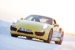 PORSCHE 911 TURBO. LEVI, FINLAND - FEB 20: Unknown driver drives a PORSCHE 911 TURBO car during Porsche Driving Experience Snow & Ice Press Event on February 20 Stock Photo