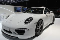 2014 Porsche 911 Turbo by TechArt on the Geneva Auto Salon. Wider, flatter and longer as its predecessors. The new Porsche 911 Turbo models make promises to Royalty Free Stock Photo
