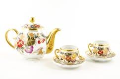 Porseleinthee en koffie met bloemmotief dat wordt geplaatst Royalty-vrije Stock Fotografie