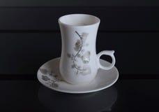 Porslin kuper av kaffe Arkivfoto