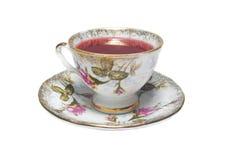 Porslin kuper av röd tea Fotografering för Bildbyråer