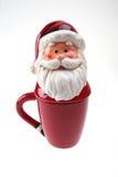 Porslin röda Santa Claus Cup arkivbilder
