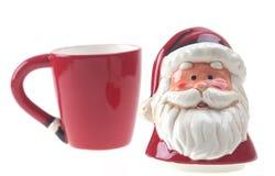 Porslin röda Santa Claus isolerade arkivbild