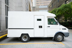 porslinkörbanan för den armored bilen parkerade den shanghai skåpbilen Arkivbild