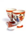 porslinkoppar skedar tea Royaltyfri Foto