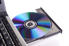 Portátil com disco de DVD imagens de stock royalty free