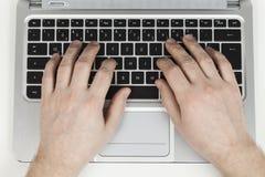 portátil com a mão 1 isolada Foto de Stock Royalty Free