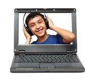 Portátil com música de escuta da criança Imagem de Stock Royalty Free