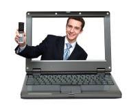 Portátil com o homem de negócios que dá seu telefone Fotografia de Stock