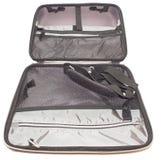 Portátil da mala de viagem em um caderno branco do fundo Imagem de Stock