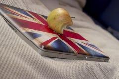 Portátil e maçã Fotografia de Stock