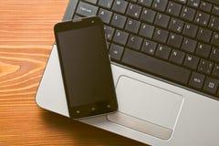 Portátil e smartphone Fotos de Stock