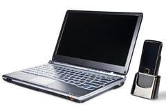 Portátil e telefone móvel Imagem de Stock Royalty Free