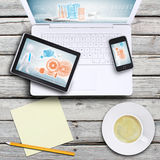 Portátil, PC da tabuleta, smartphone e copo de café Imagens de Stock Royalty Free