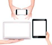 Portátil, tabuleta digital e telefone celular com mão Foto de Stock