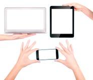 Portátil, tabuleta digital e telefone celular com mão Fotografia de Stock