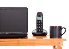 Portátil, telefones celulares e copo de café Fotografia de Stock