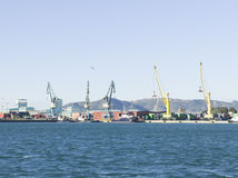 Port. View of several cranes at the port Stock Photography