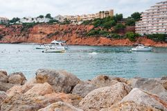 Residential buildings on red sedimentary rocks. PORT ADRIANO, MALLORCA, SPAIN - NOVEMBER 15, 2011: Residential buildings on red sedimentary rocks in the marina Stock Photography