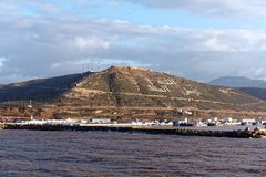 Port of Agadir in Morocco. A view from the sea of the port of Agadir. The hill bears the inscription in Arabic: God, Country, King Royalty Free Stock Images