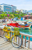 The port of Alanya with yellow bicycle Stock Photo