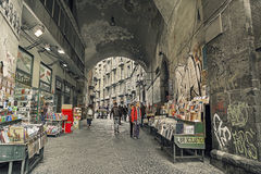 Port'Alba, remnant of one of the city gates of  Naples. Italy with Via d'Alba,historic street booksellers, in old town Royalty Free Stock Image