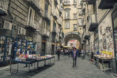 Port'Alba, remnant of one of the city gates of  Naples. Italy with Via d'Alba,historic street booksellers, in old town Stock Image